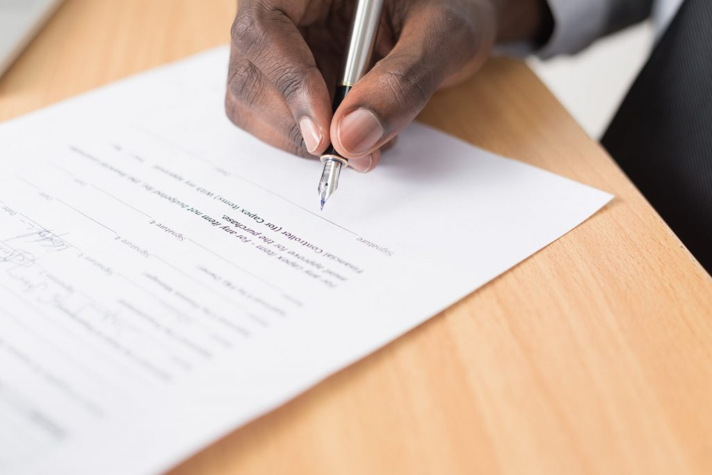 LGBT Lawyers - Arbitration - Man signing a document
