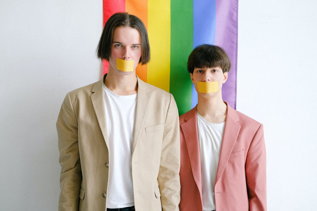 LGBT Discrimination - Men with tape over face