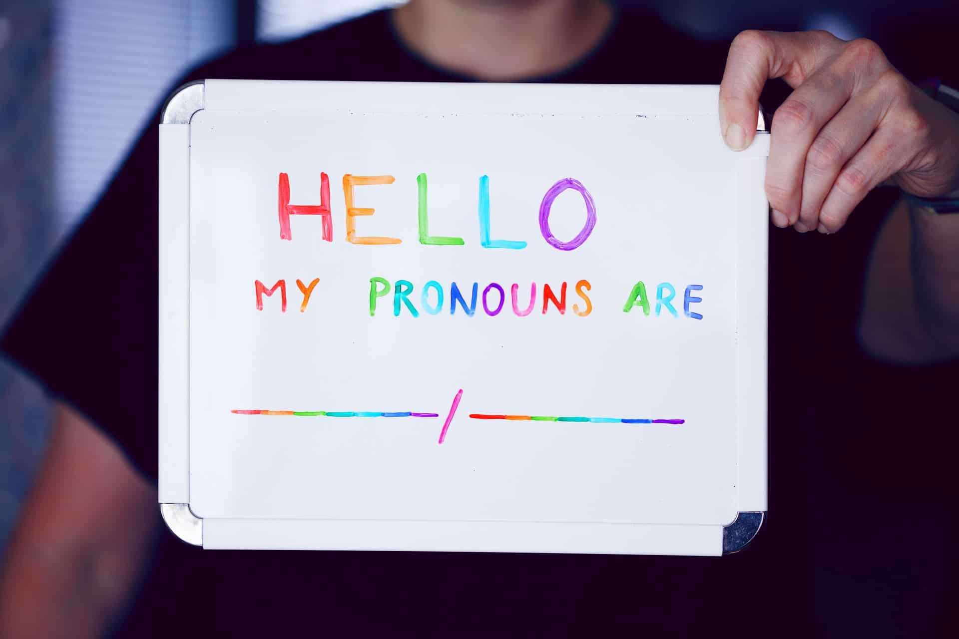 LGBT Lawyers sign saying my pronouns are for keira bell case