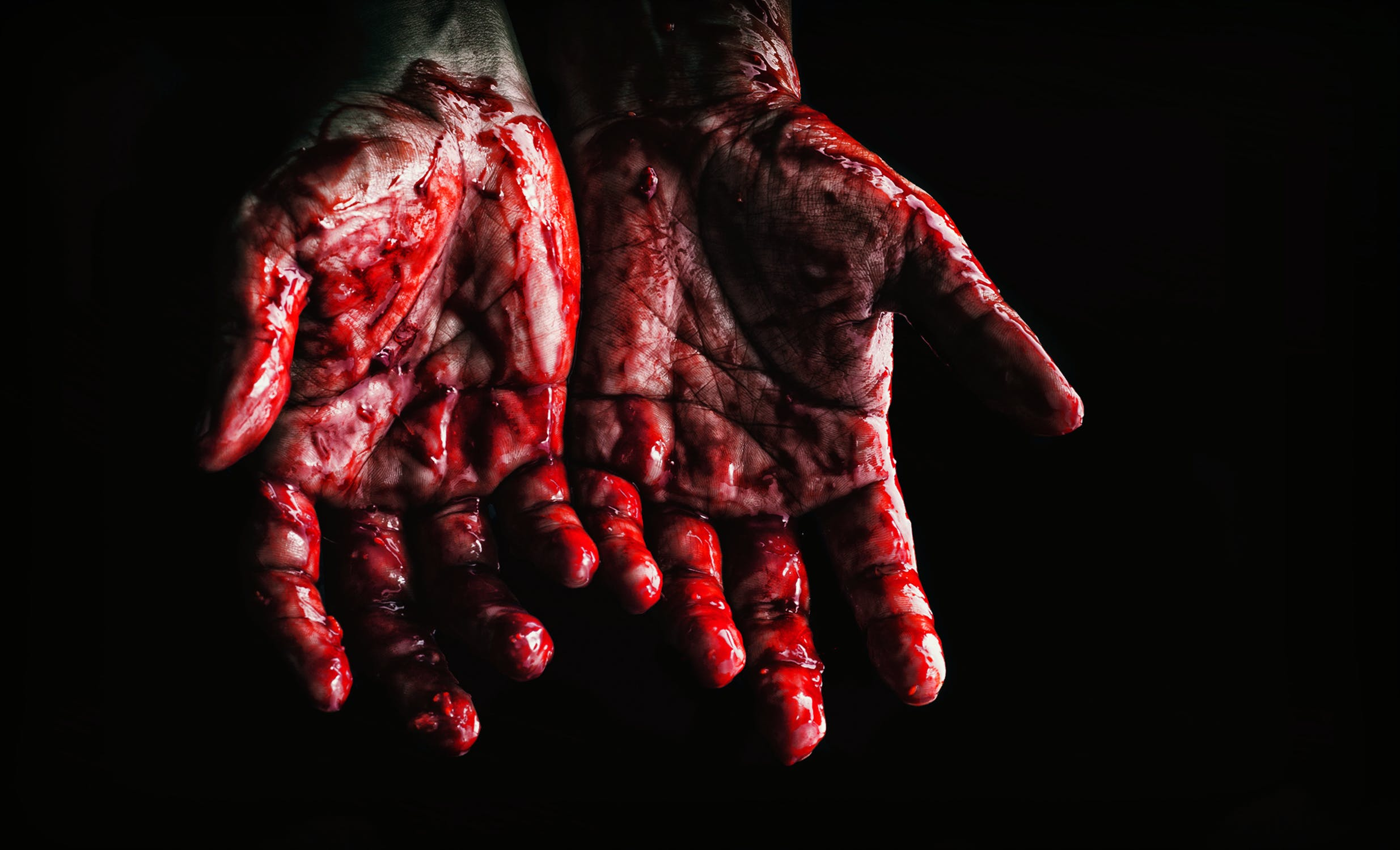 LGBT Lawyers a pair of bloody hands after a violent crime