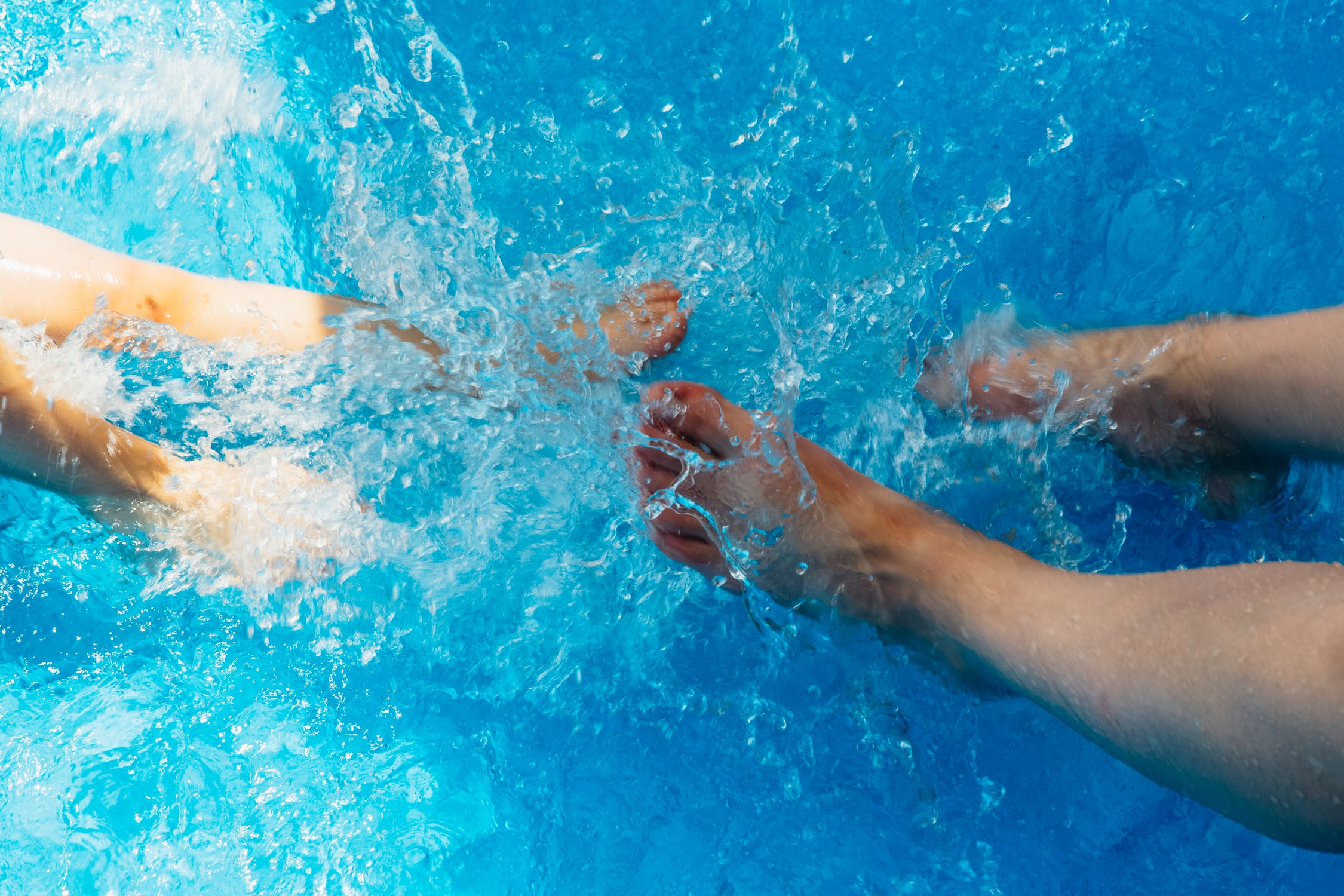 LGBT Lawyers a picture of feet in a swimming pool before ordinary negligence