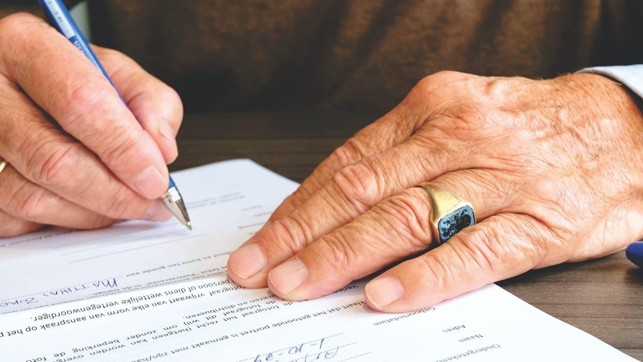LGBT Lawyers an elderly man writes a codicil