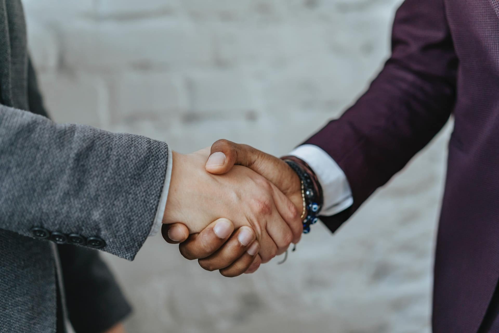 LGBT Lawyers two men shake hands before a case of negligence