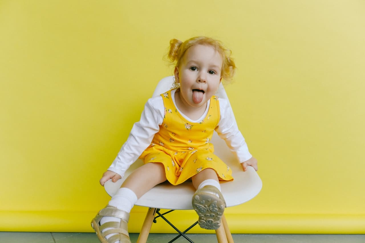 child in a yellow dress during same sex parenting