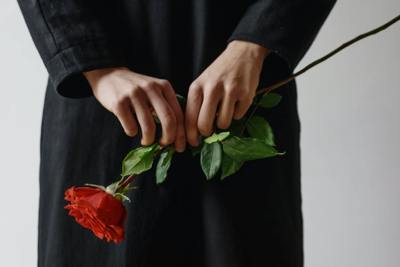A woman holding a rose during the application for a PA1P form