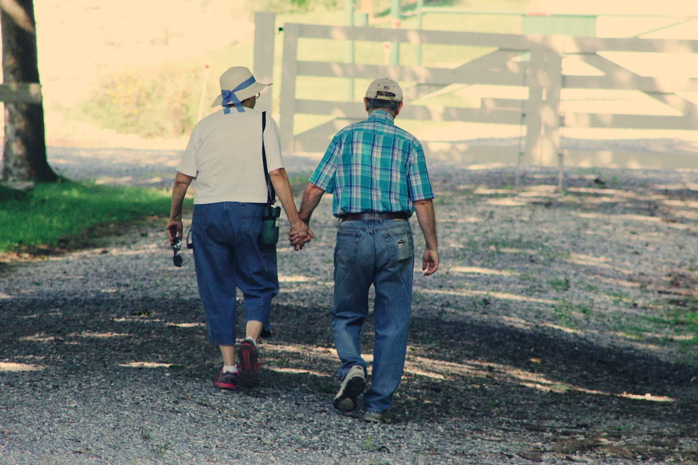An elderly couple holding hands after a PA1P form