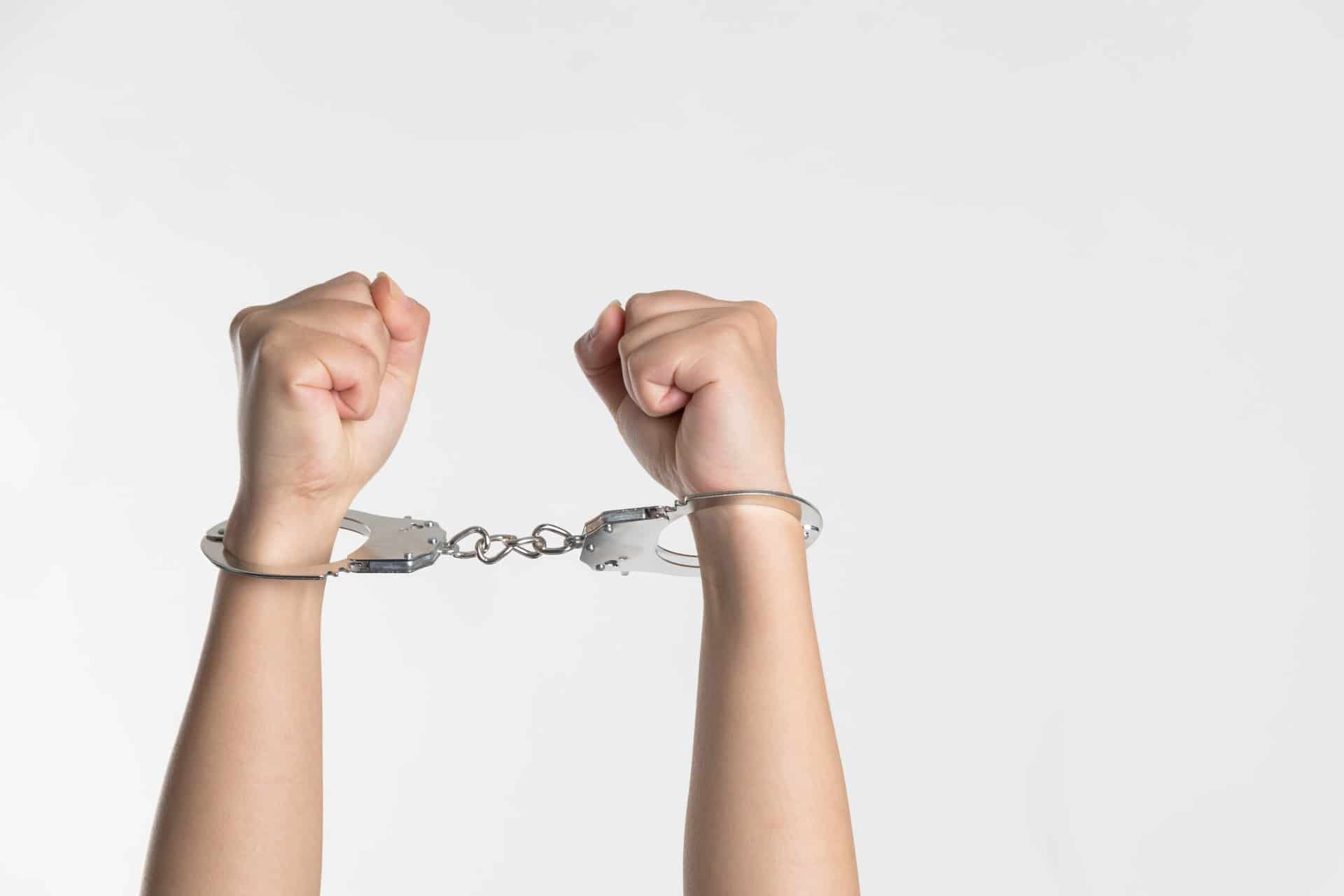Two hands in handcuffs about to serve a community order offence